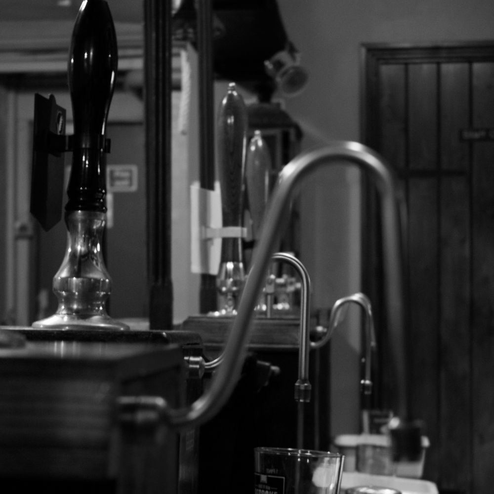 Photograph looking down the inside of our bar, looking at our beer spouts